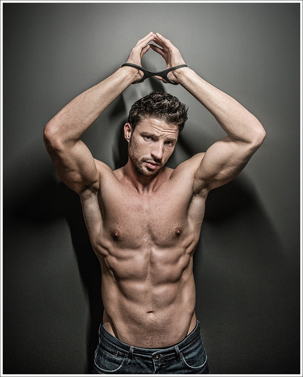 Topless male model in Quickie cuff handcuffs