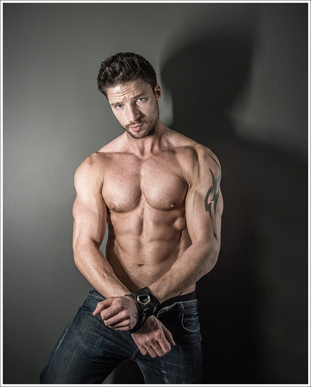 Topless male model in SXY Cuffs handcuffs