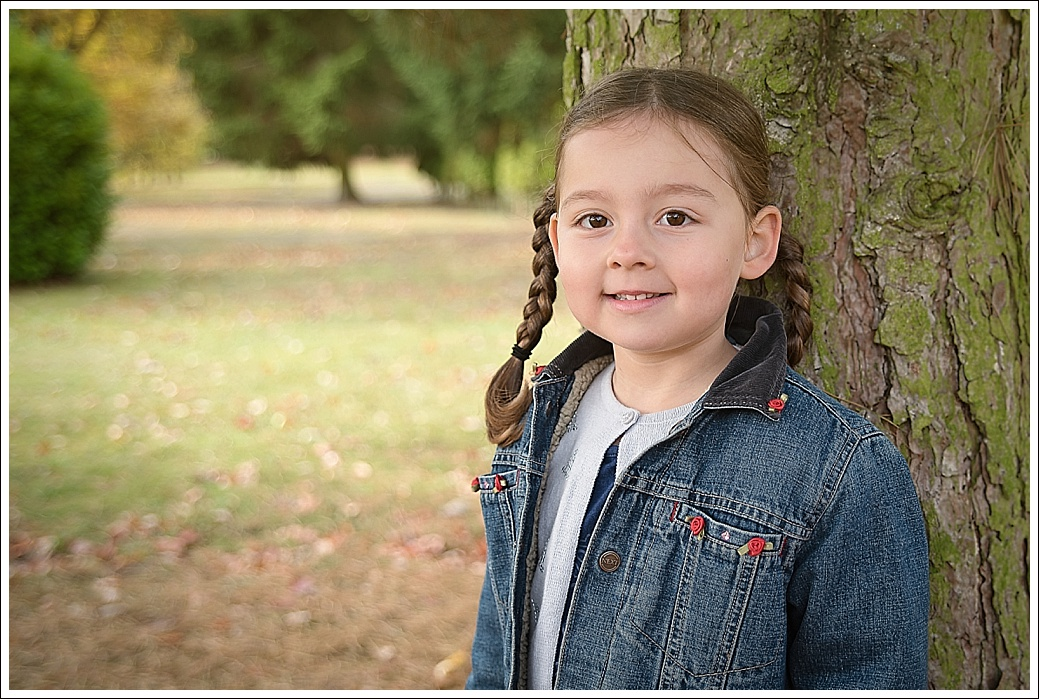 Child photograph outdoors in autumn