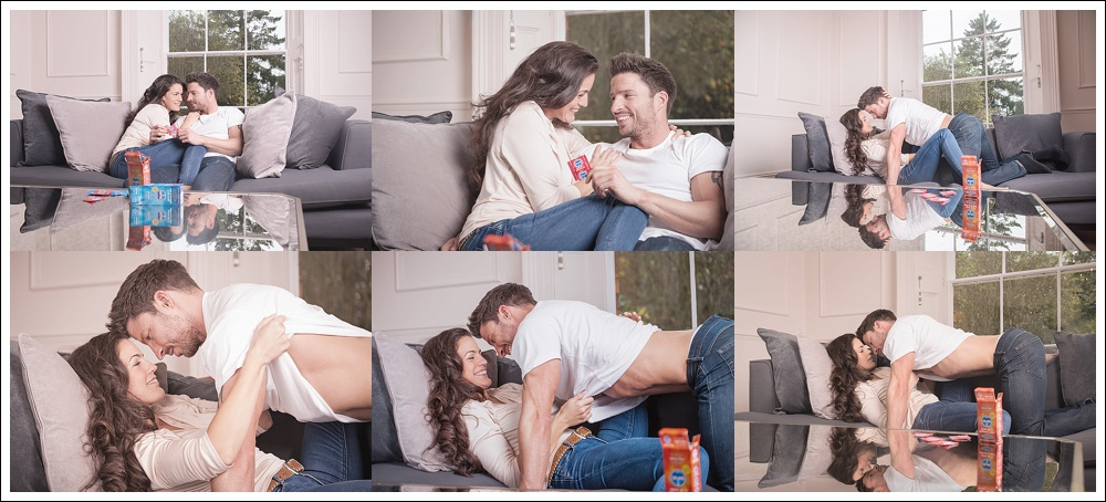 Man and woman on sofa with Skins condoms