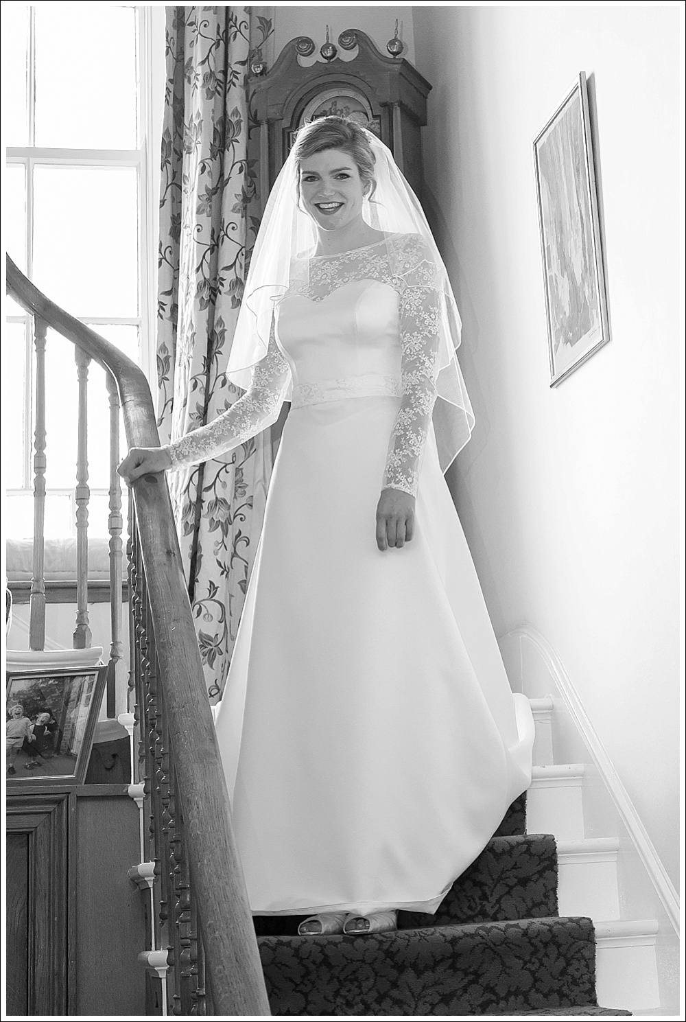 Bride coming down stairs before wedding